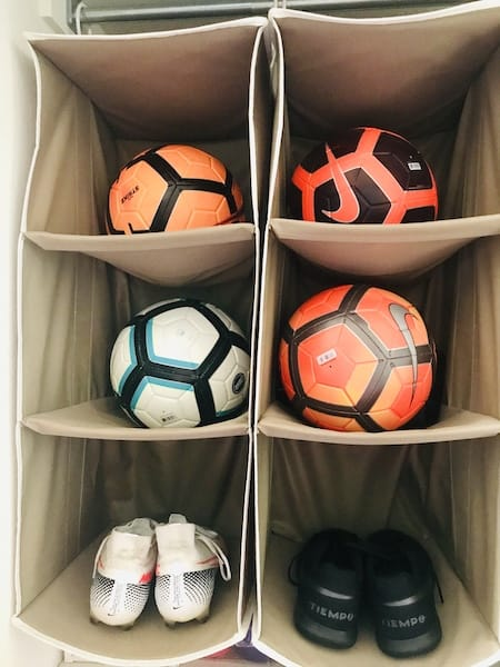 Organize a teen's bedroom: athletic equipment on hanging shelves