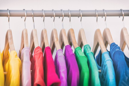 Organizing a bedroom armoire: arrange clothes by color